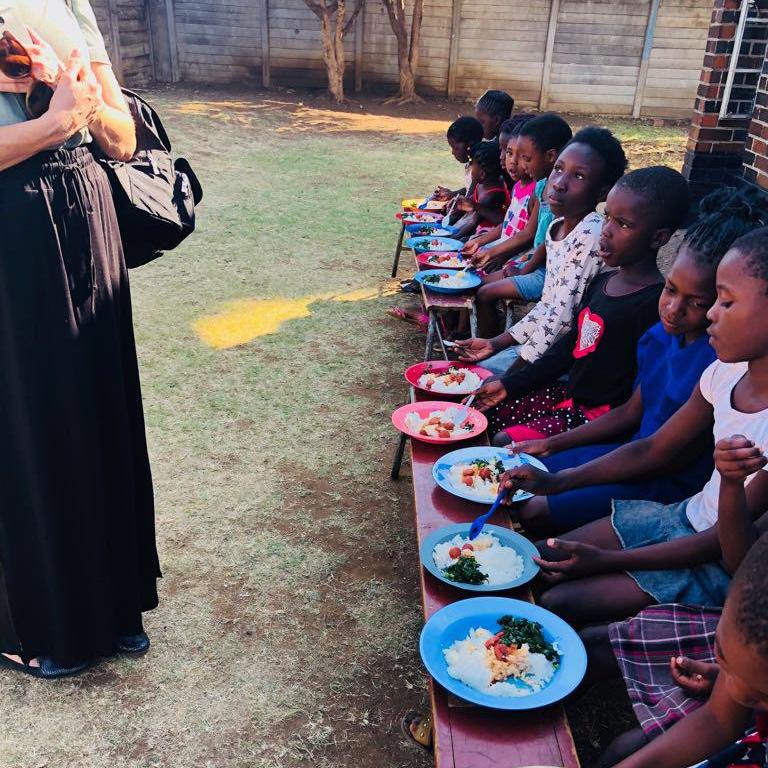 Feeding children at Rugare