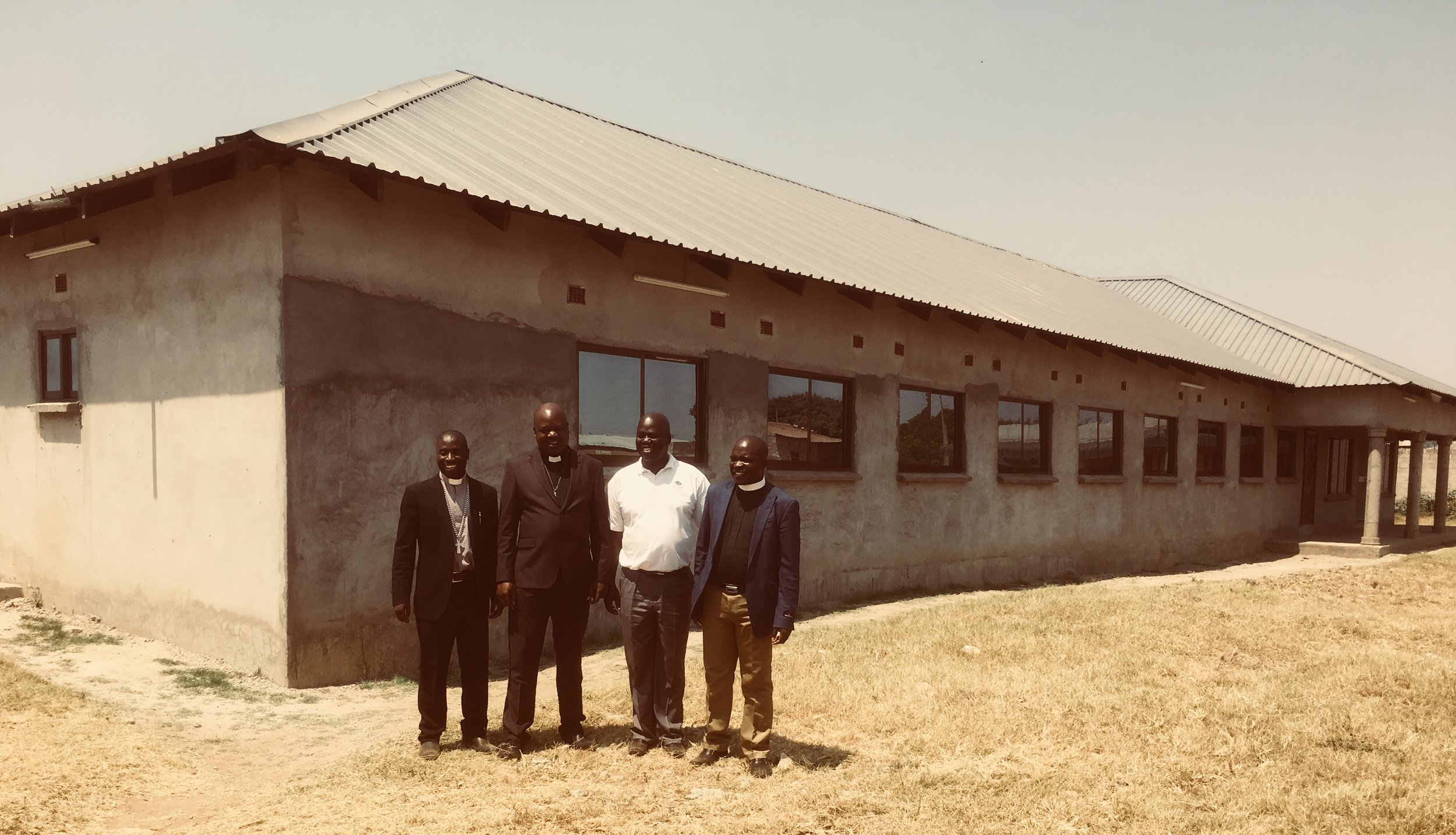 These are the CCAP Synod of Zambia leaders in front of their new (almost finished) office building. From left to right: Rev. Sevatt Kabaghe (General Secretary), Rev. Friday Kabakasa (Moderator-elect), Rev. Dr. Daniel Tembo ( Deputy General Secretary), Rev. Chisazon Chanda (Moderator).
