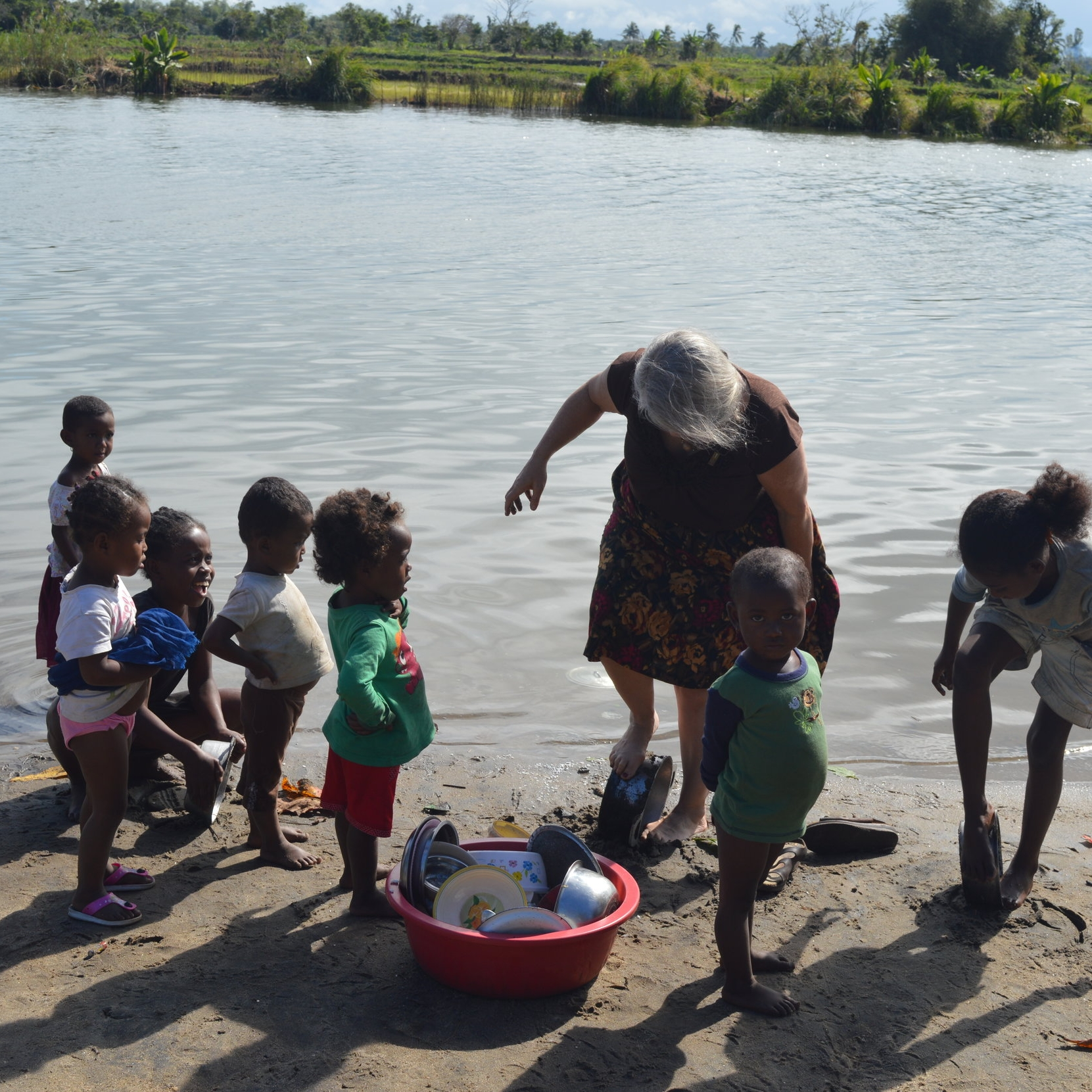 Elizabeth learning to wash cooking pots at Antetezampasika, where the first missionaries arrived 200 years ago.