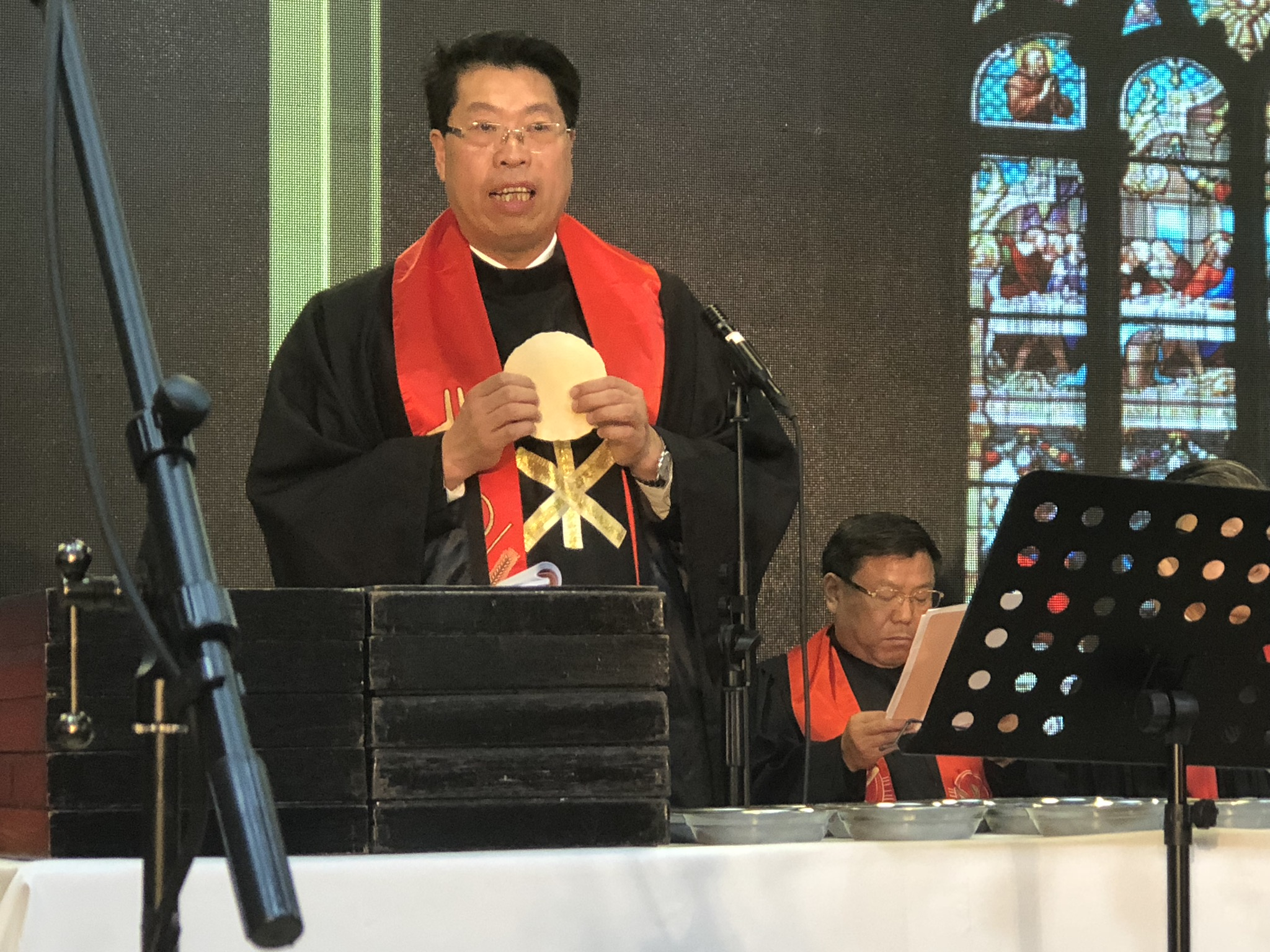 Rev. Zhang, Provincial Chairman, officiating over communion