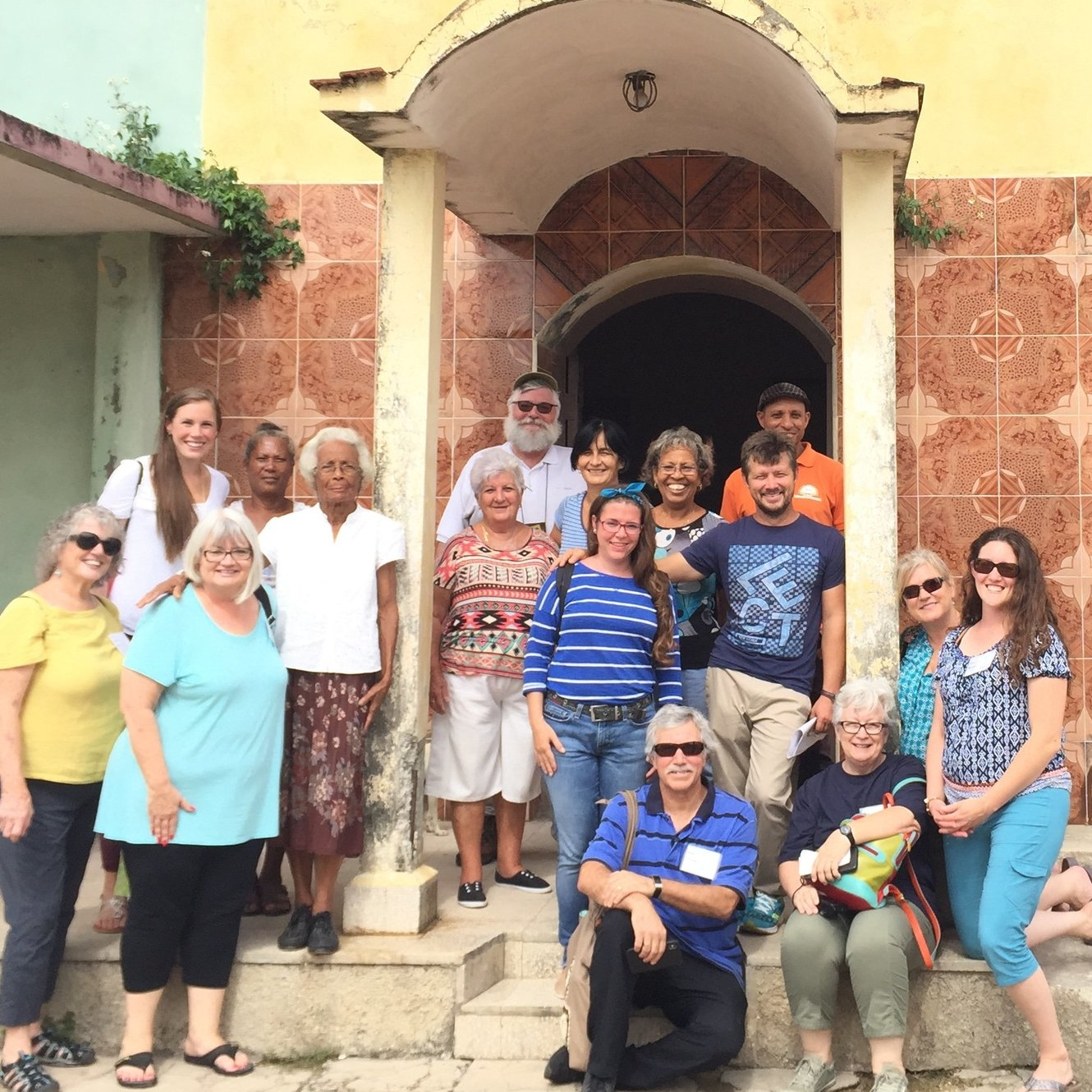 Our team on the steps of Resurrection Church in Sabanilla