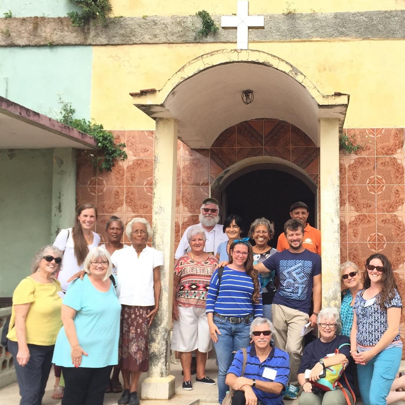 Outreach team on the steps of the Resurrection Church in Sabanilla