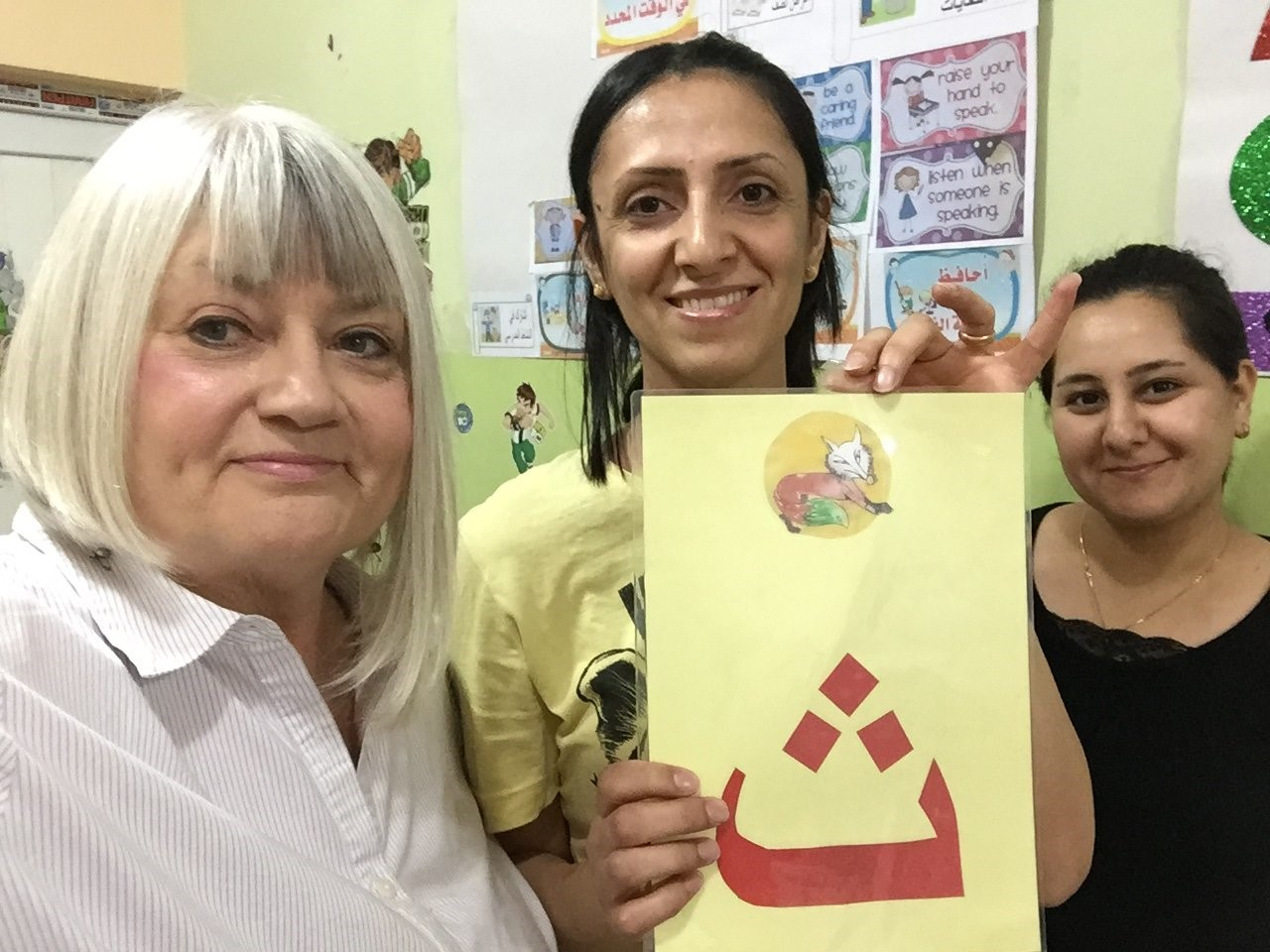 Marilyn learns her first Arabic letter at the Good News Kindergarten