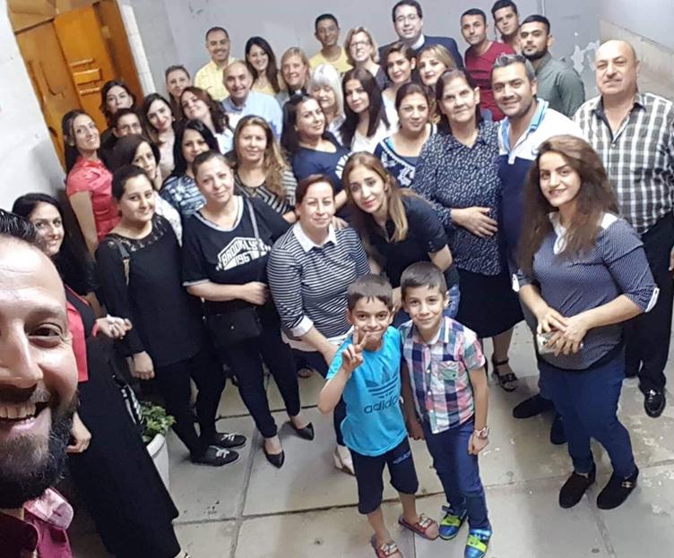 Fellowship after worship at Kirkuk Church