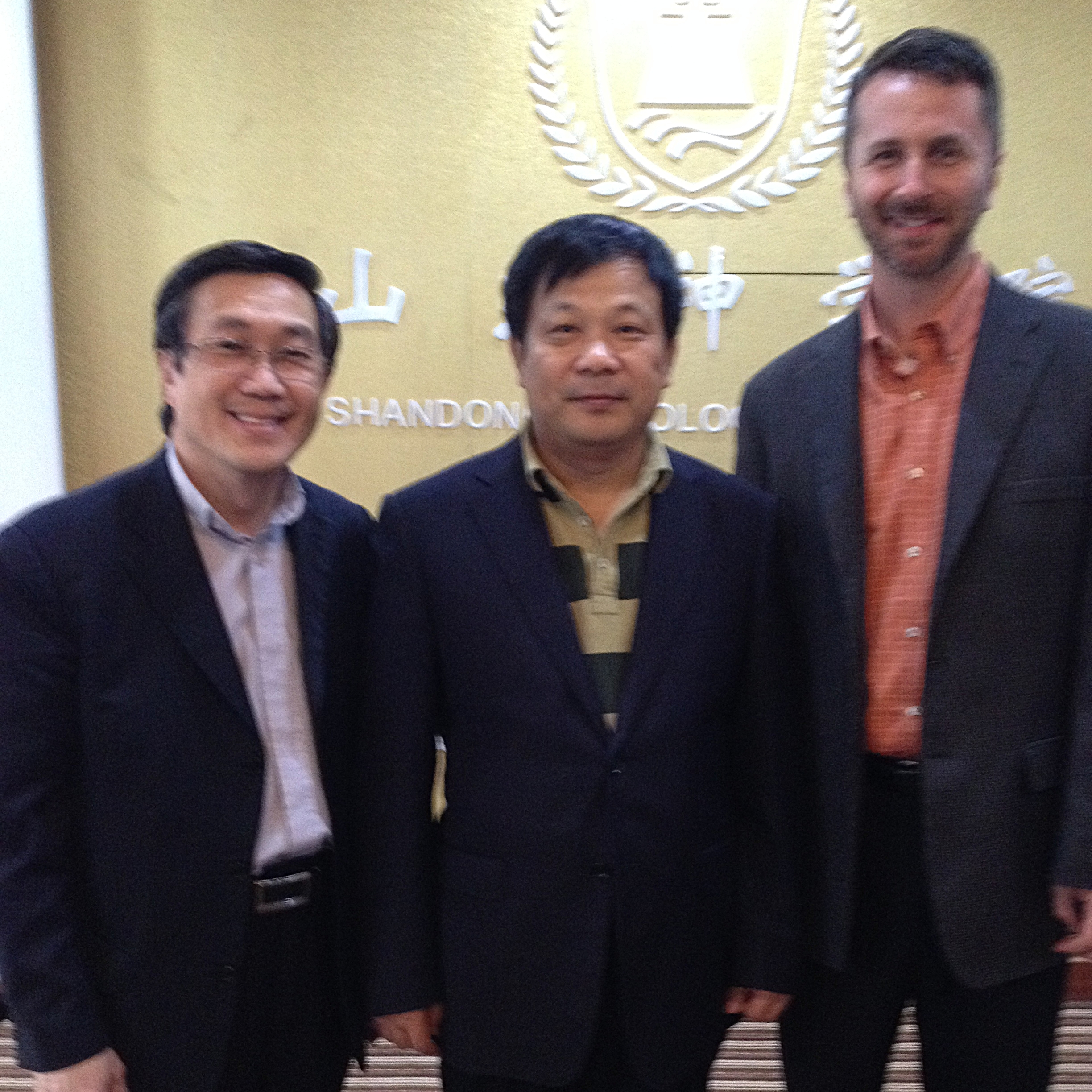 The visionary leader of the Shandong Provincial Christian Council, the Rev. Gao Ming, shown at Shandong Seminary between Peter Lim and Shadyside's Todd Leach