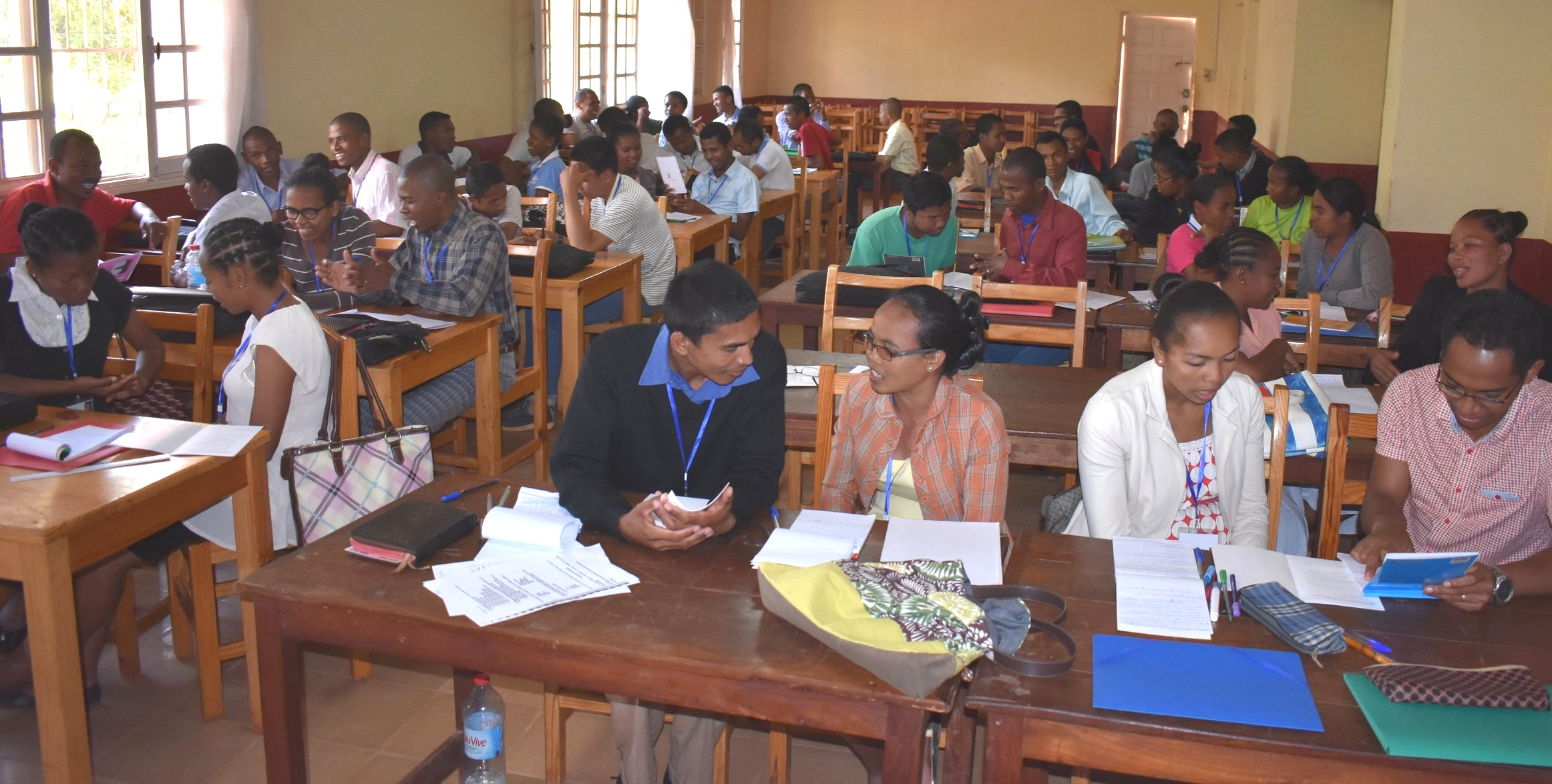Seminary students practicing counseling techniques during AIDS training.