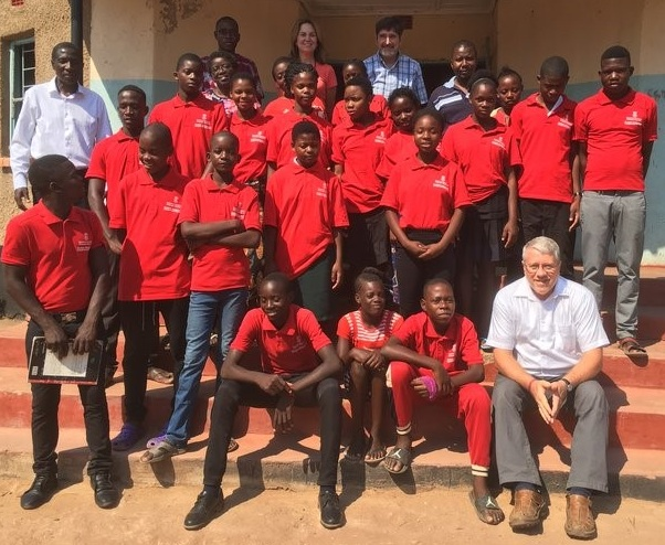 An Outreach team including Frank Dimmock, Ted and Sue Wright, Jennifer L. Ellis and Ebralie Mwizerwa traveled to Siavonga in September to visit the children and meet the Namumu Board of Management. Pictured here with the team and children are Namumu board members including Board Chair Leonard Hachitapika.