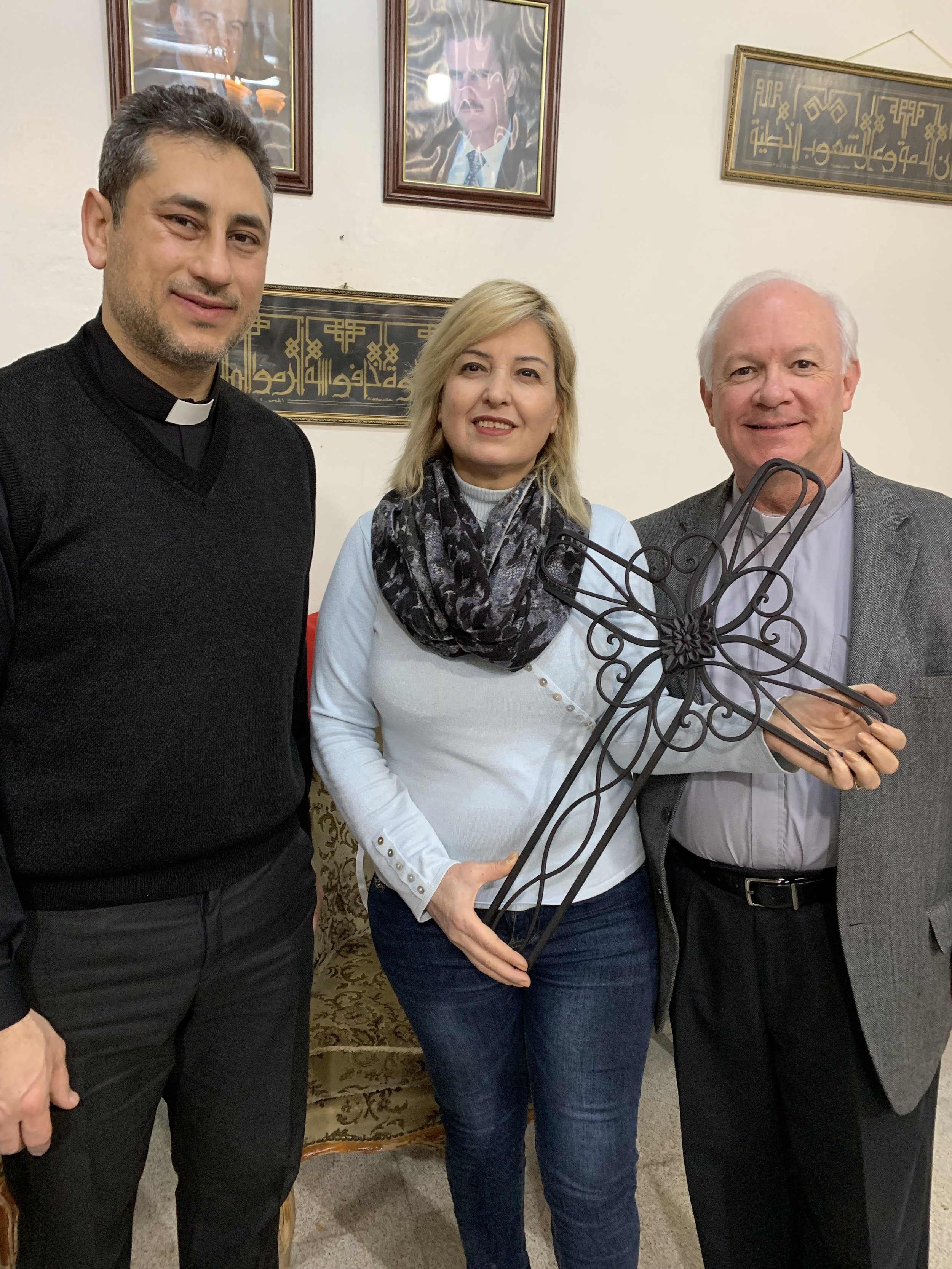 The cross binds us together in unity. Jack leaves a gift with Rev. Firas and church member Bianka in Qamishly before we depart