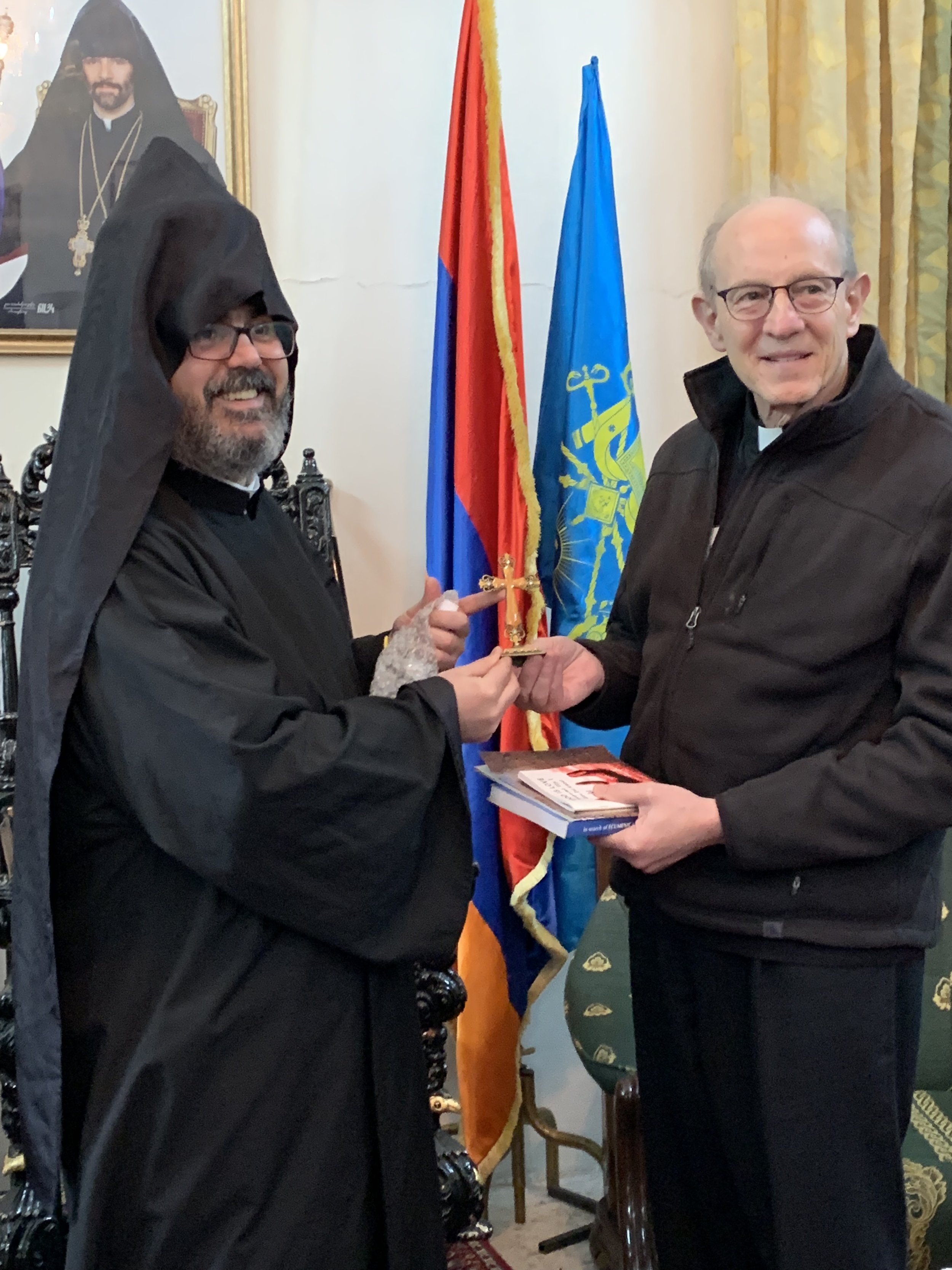 Rob receives the gift of an Armenian cross from the Armenian Orthodox bishop Reuben Abandian
