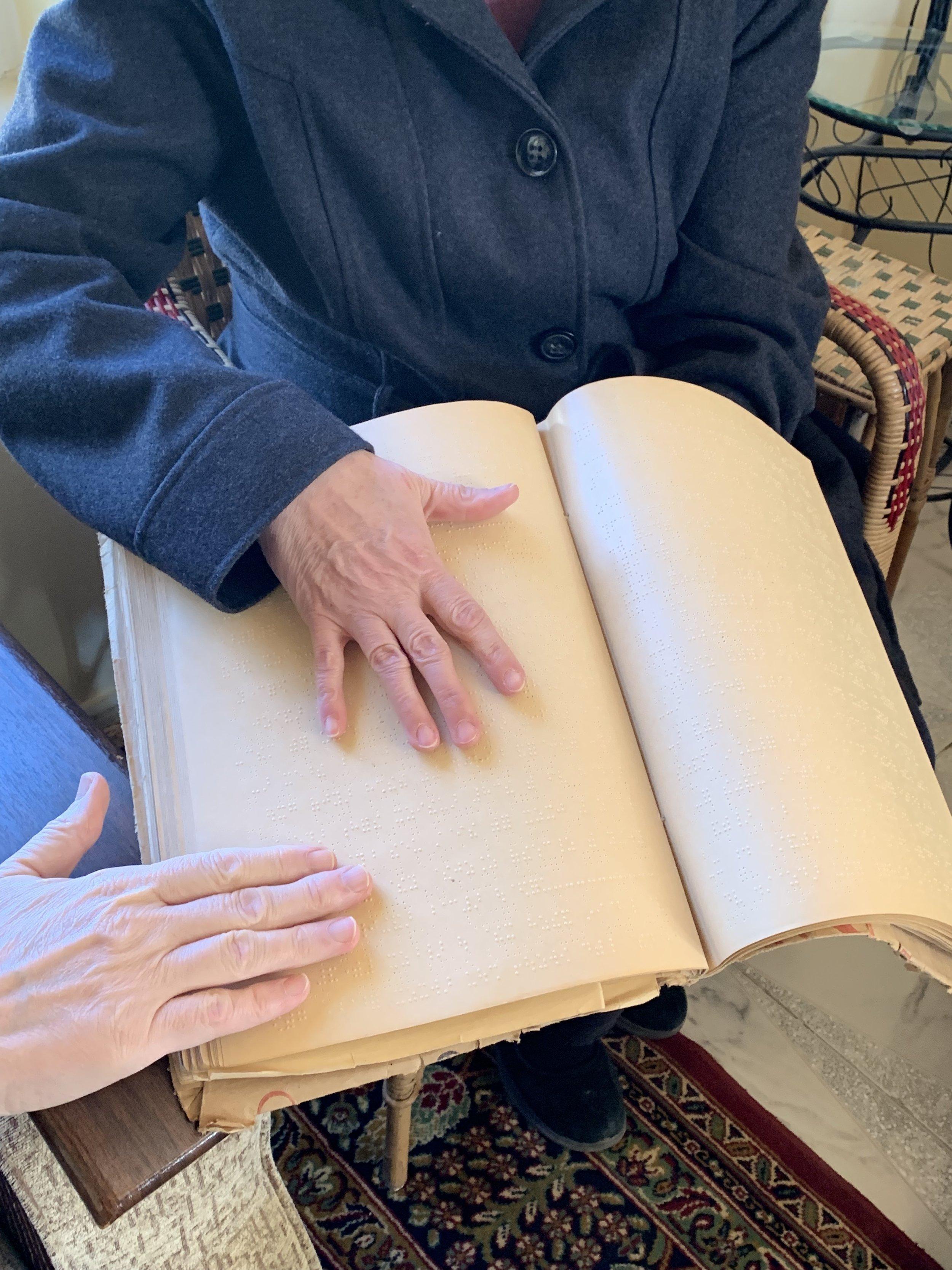Feeling God's praises in an old Braille hymnbook
