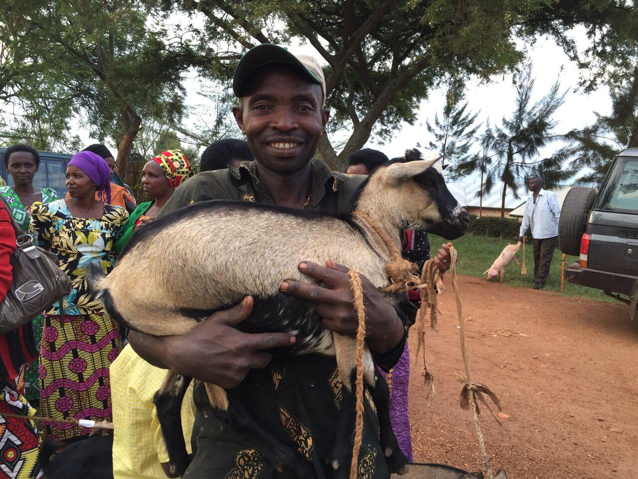 Goats for Rwanda gentleman with goat (2).jpg