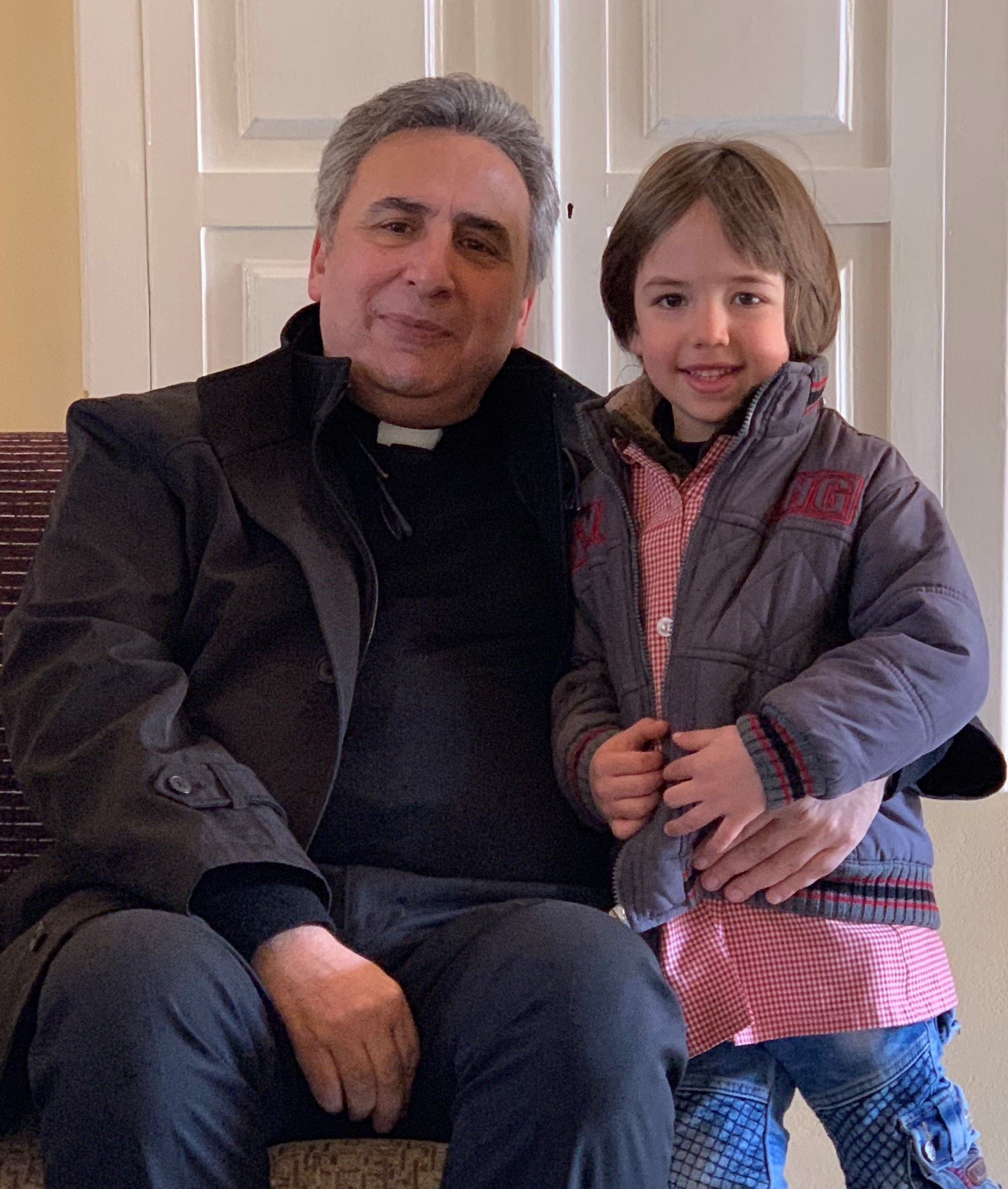 Last fall Rev. Kassab baptized young Christian, whose parents had waited until the church was repaired after damage sustained in the war. Christian was baptized at the rededication service!