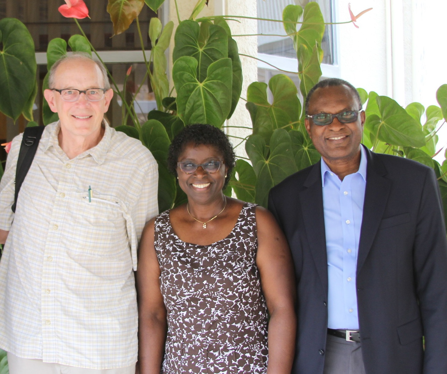 Outreach Executive Director Rob Weingartner, Projects Coordinator Ebralie Mwizerwa and  PIASS Vice-Chancellor Rev. Dr. Elise Musemakweli