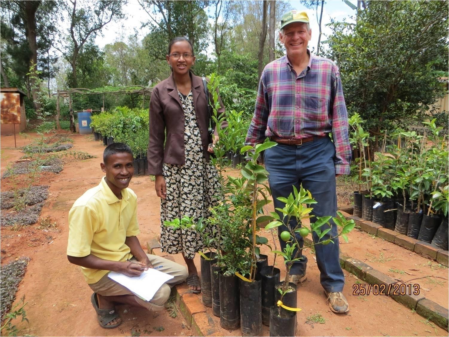 Pastor Clara receiving her fruit trees in 2013