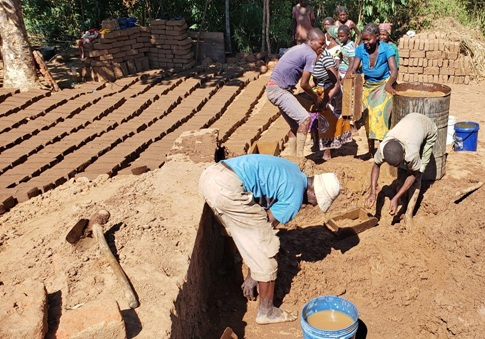 Amphande Church members molding bricks