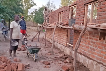 Working on Khanga teachers' house