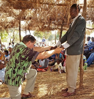 Rev. Jeff Hosmer adds drama to his sermon at Madzimaera