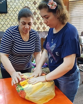 In the sanctuary of the Kirkuk Presbyterian Church, a team lovingly and prayerfully packs gift bags for the prisoners.