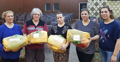 Mayada (second from the left) and her team gather up the gifts to bring to the prisoners.