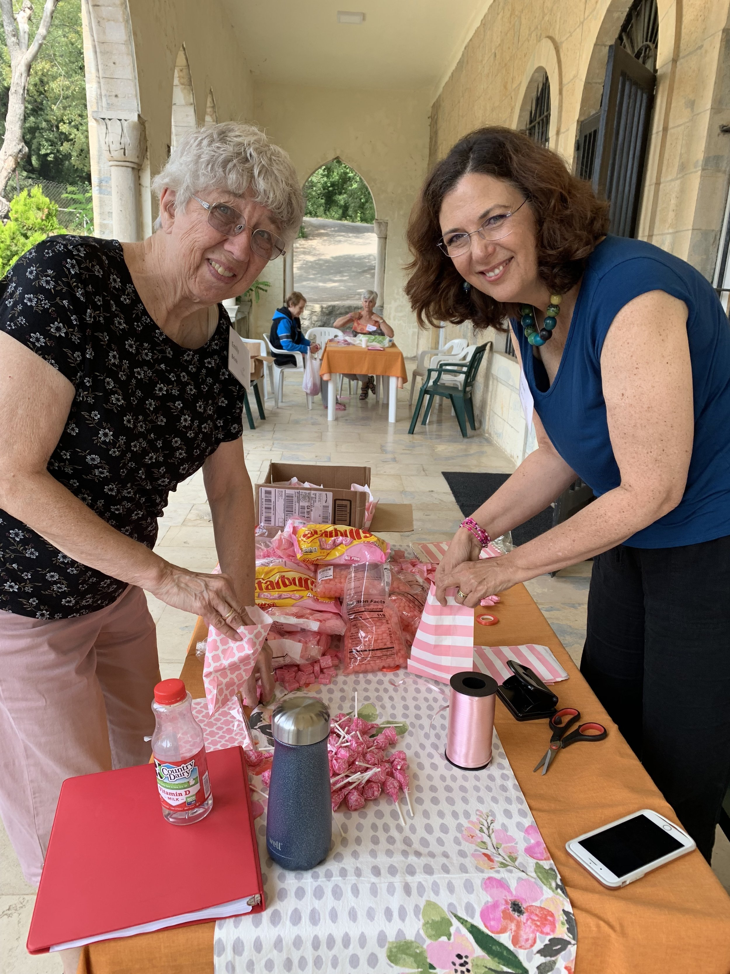 Emily and Susan P. filling the candy bags