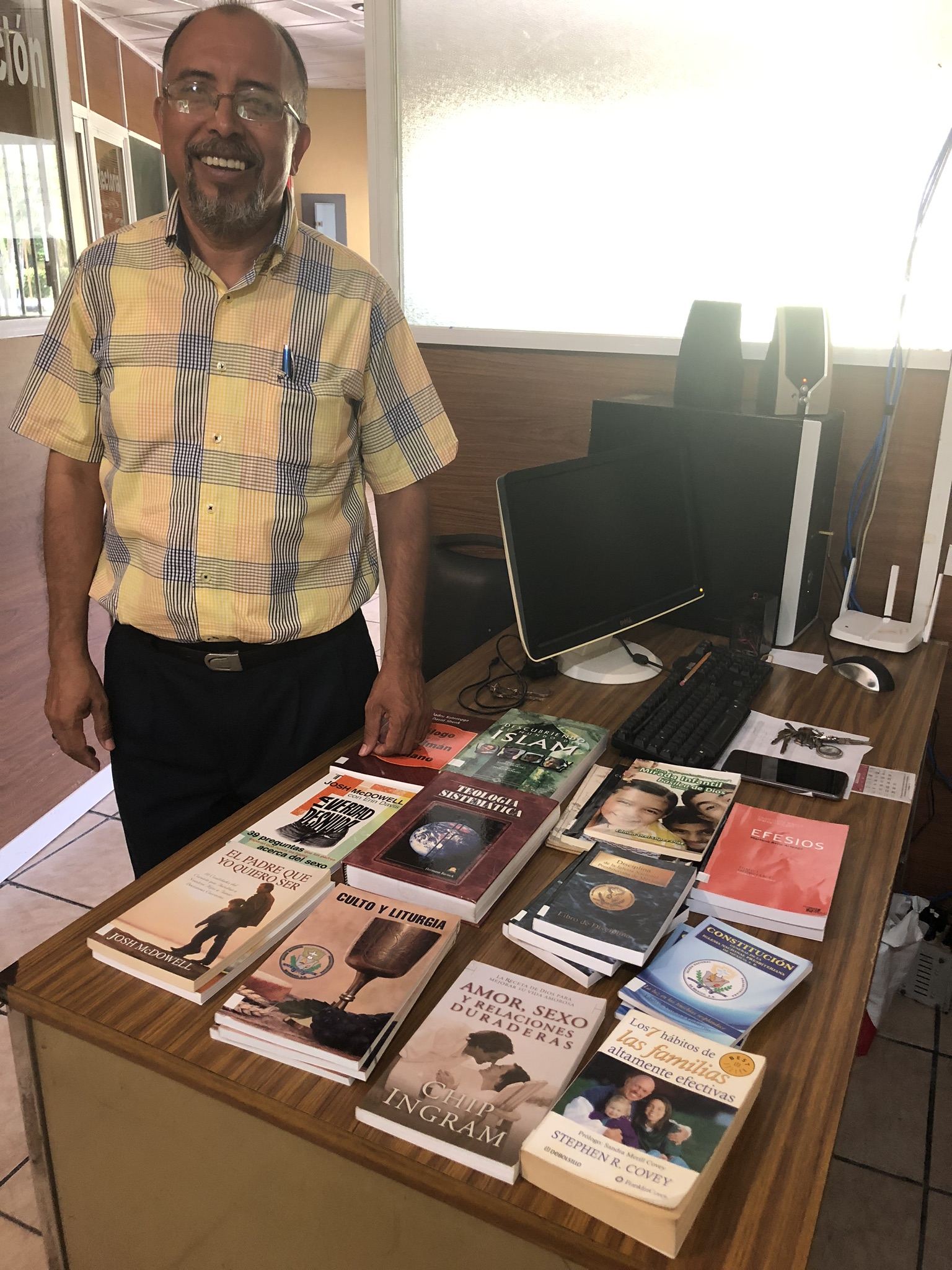 Rev. Jose Juan Hernandez, Director of Sureste Seminary with some of the new books in its library