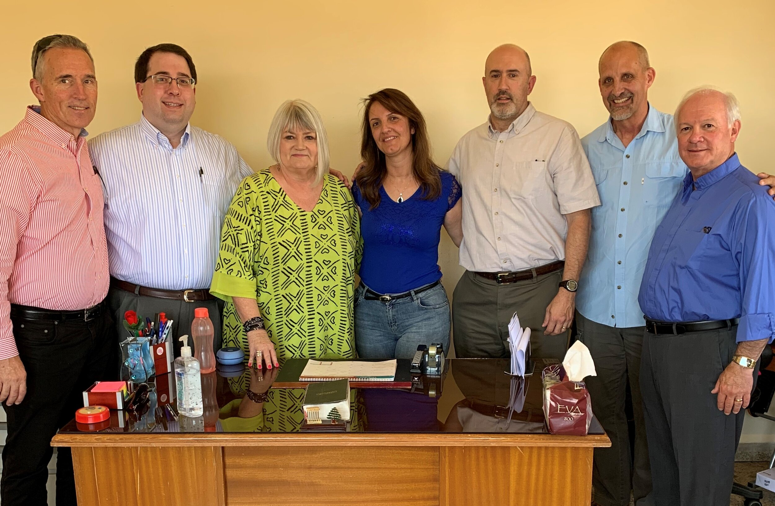 The Outreach Foundation team (Mark Mueller, Tony Lornenz, Marilyn Borst, Chris Weichman, Mike Kuhn, Jack Baca) with Ramak Abboud (center) who oversees the refugee school in Kab Elias