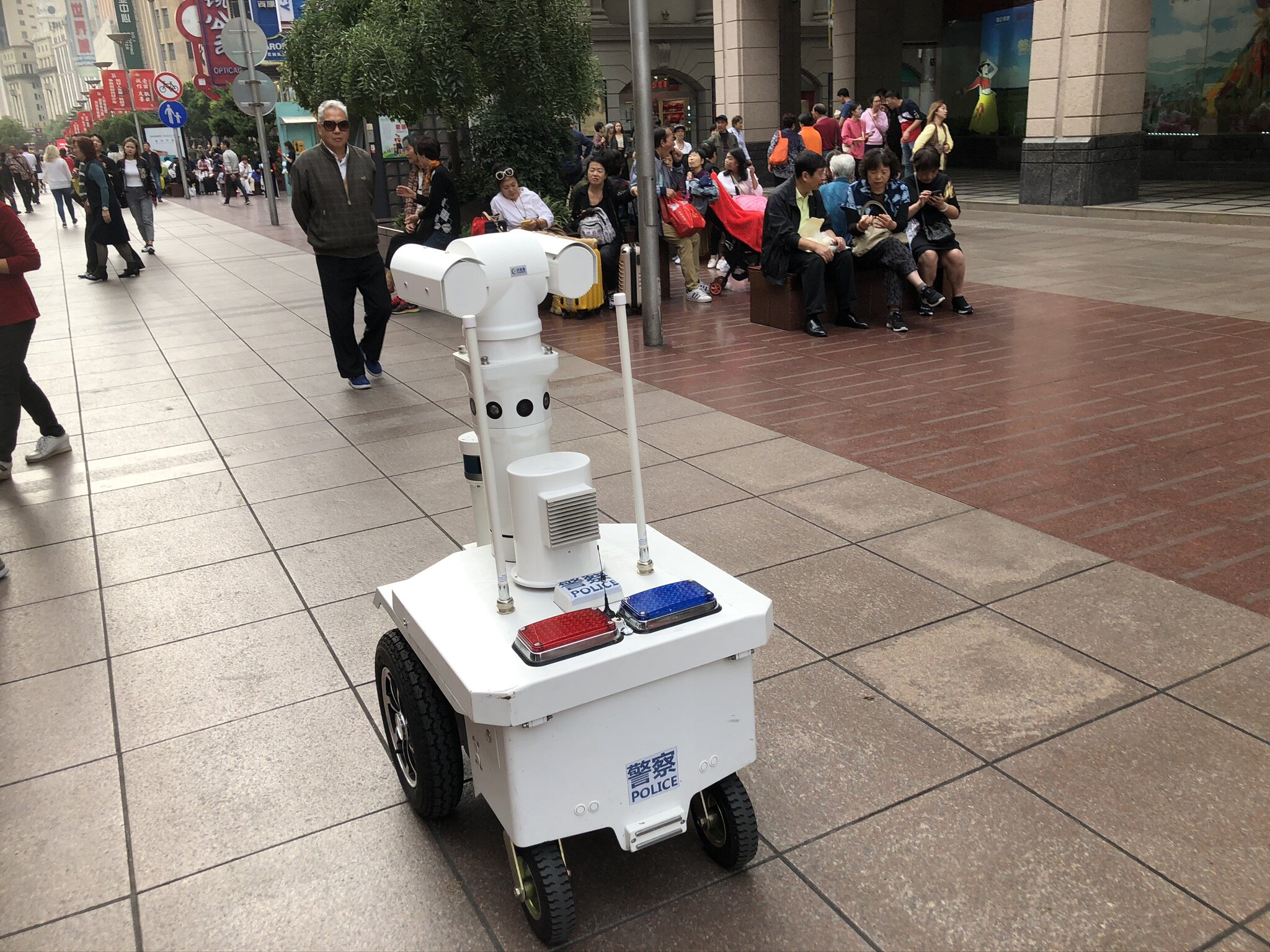 A robotic police patrols the streets
