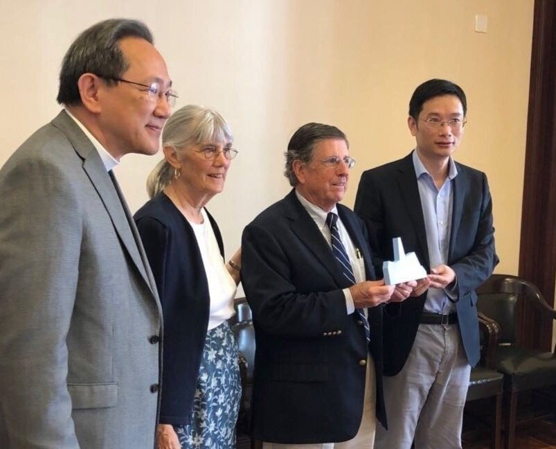Rev. Bill Teng and Tim and Julie Patterson from Ardmore Presbyterian Church in Philadelphia present a gift to Mr. Gu