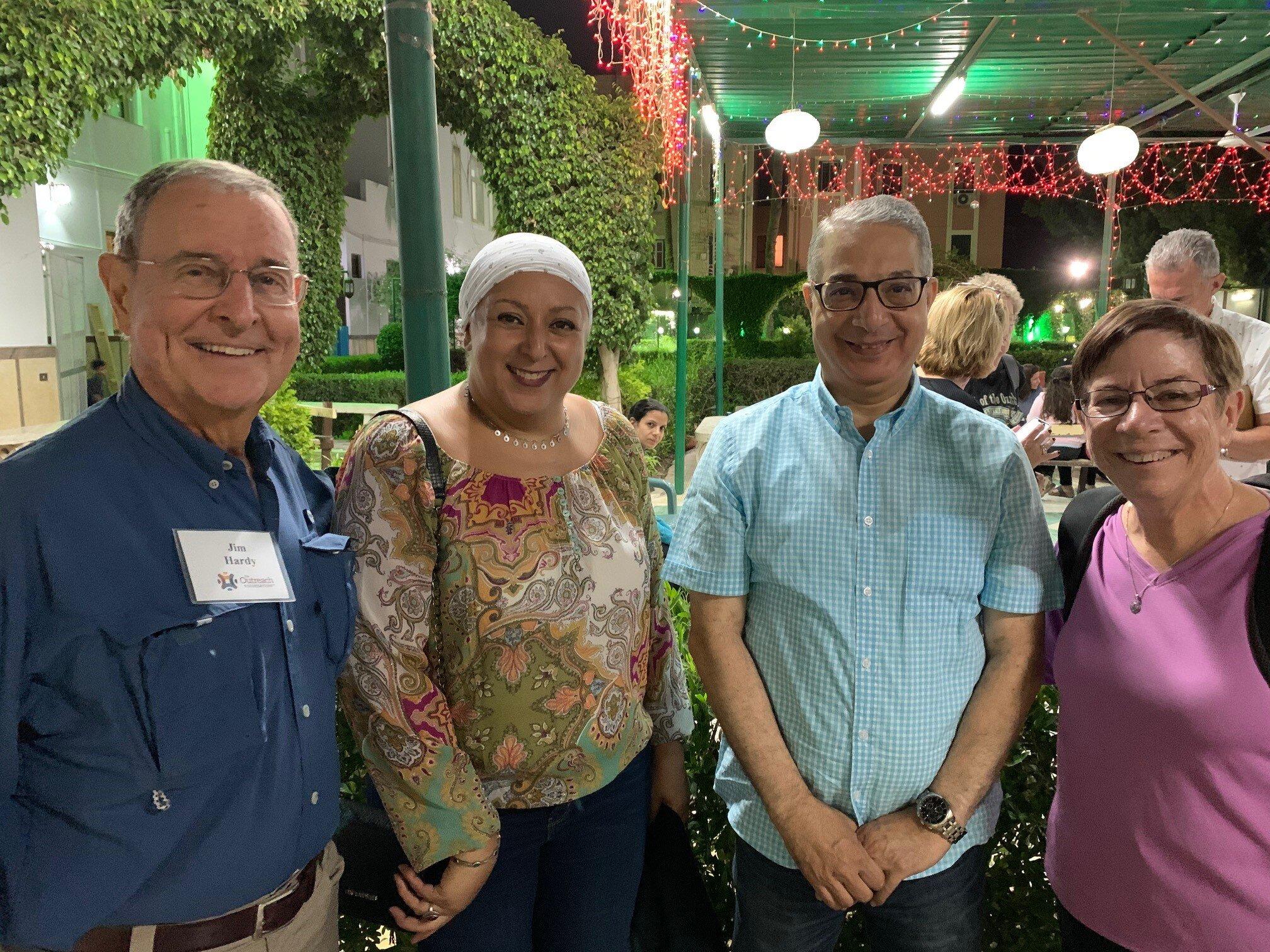 Jim Hardy (left) and Deena Candler (right) make new friends at the Zahraa El Ma'adi Church