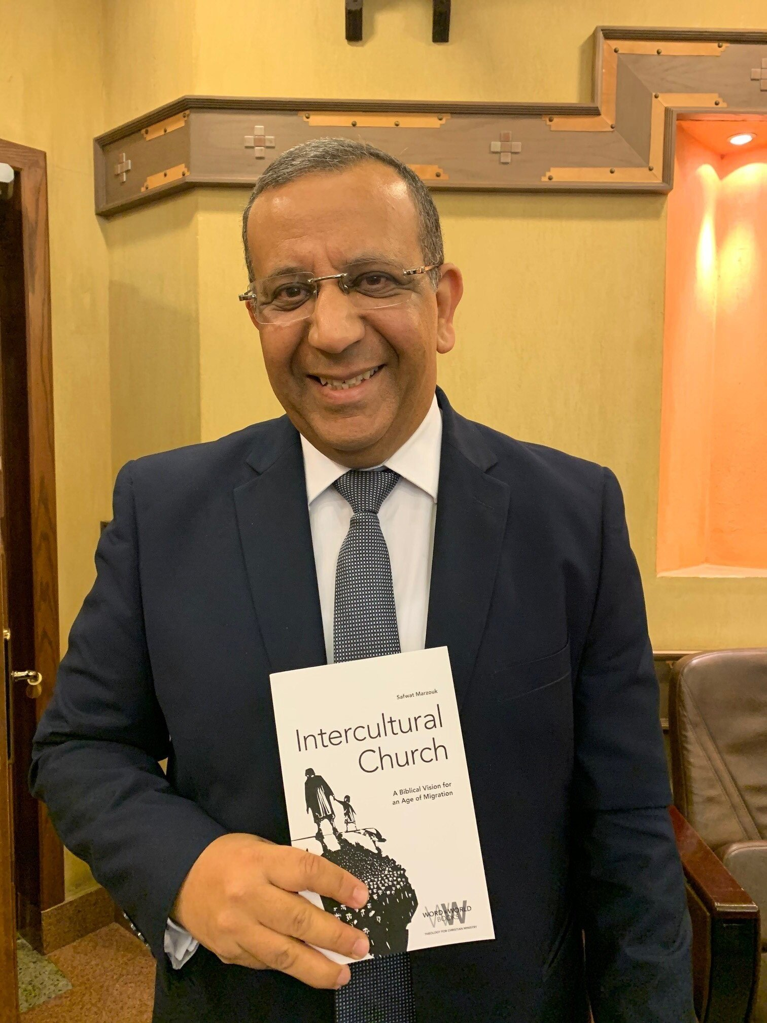 Dr. Atef with a book just published in the U.S. by a 2001 ETSC grad, Dr. Safwat Marzouk