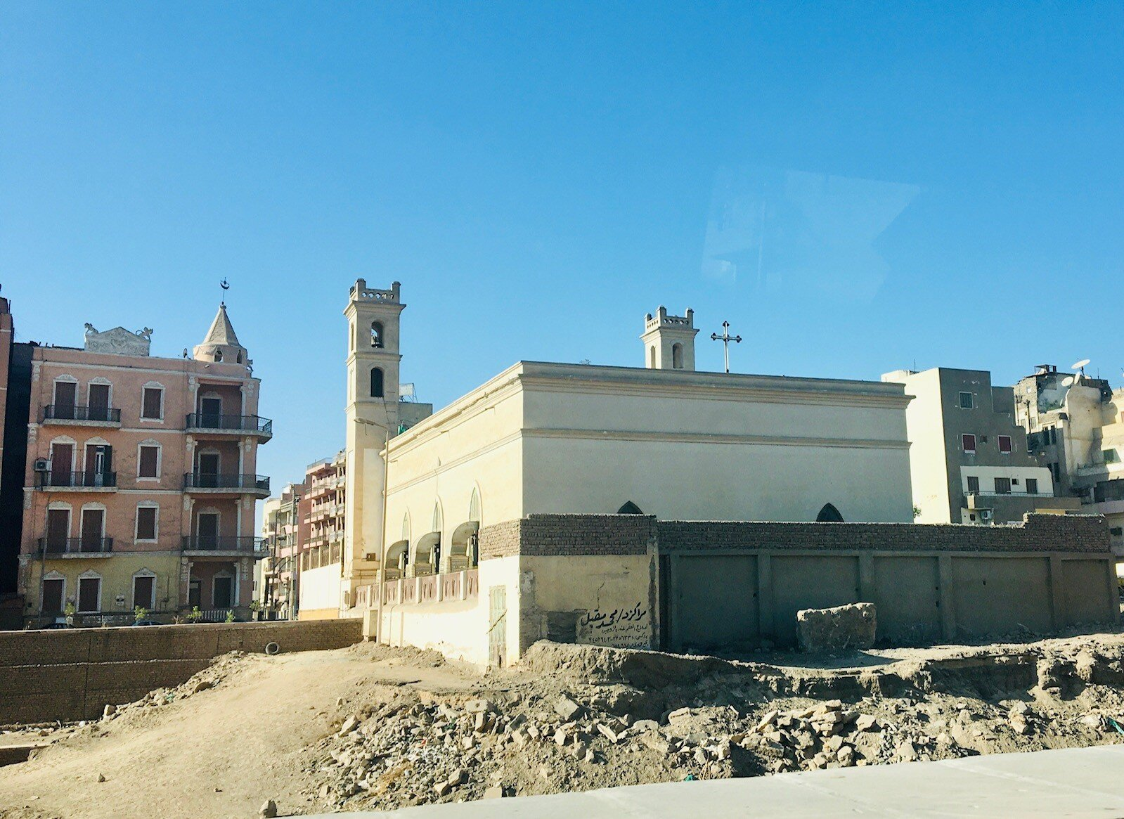 The Presbyterian Church of Luxor (notice the encroaching archeological dig site)