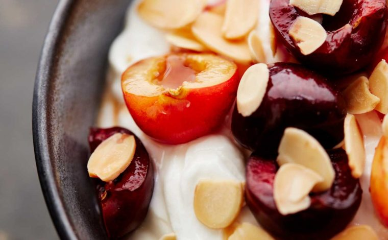 Homemade vanilla yogurt with cherries and almonds