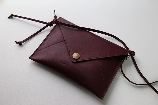 The envelope clutch in plum with a removable strap. American tanned Horween leather, solid brass hardware. Built and guaranteed to last a lifetime. Link in profile.