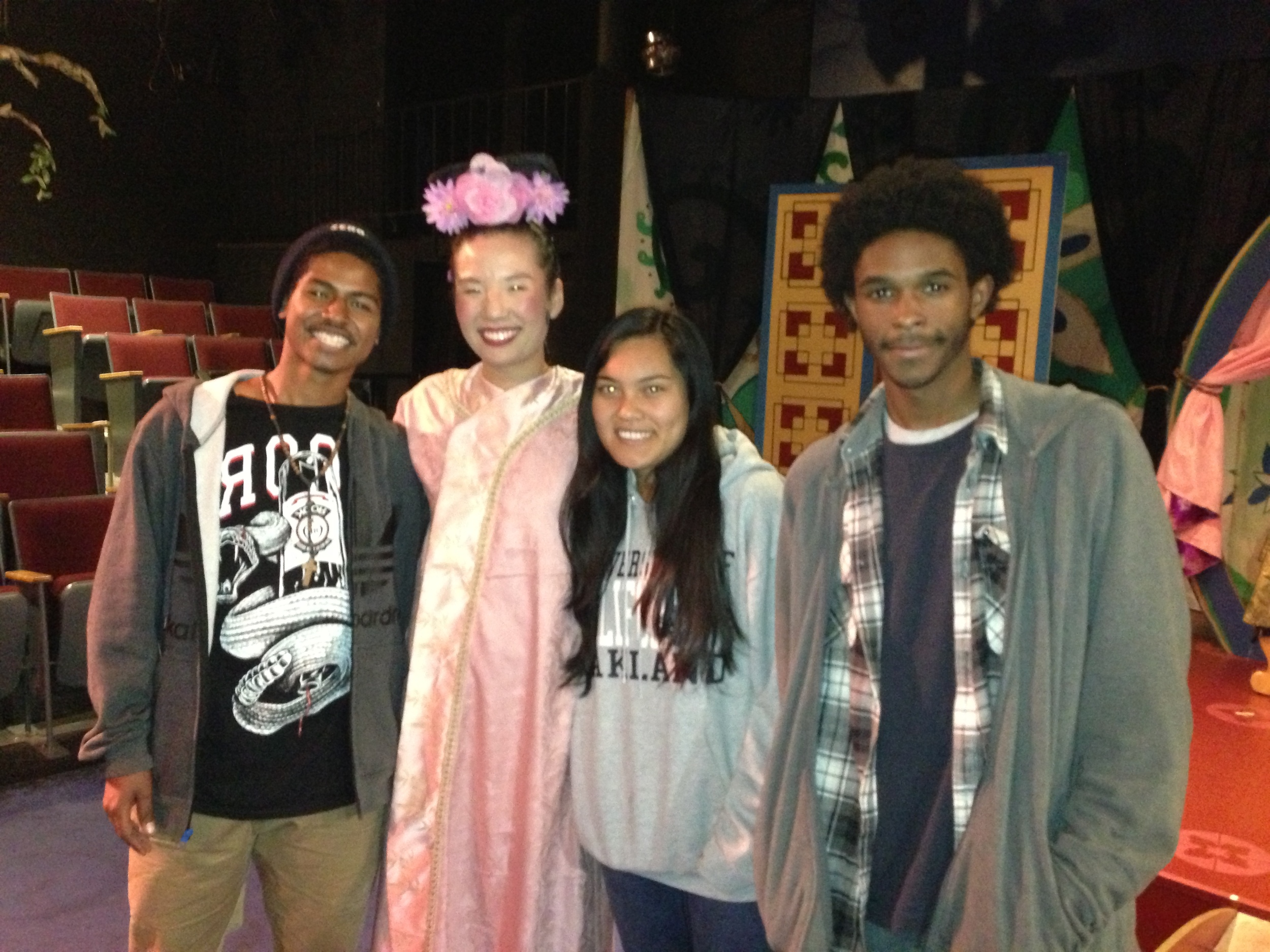 Ji-Yun Kim (second from the left) with former students (from left to right)   Roy Christopher, Tina Tieng, and Rashond Grant .