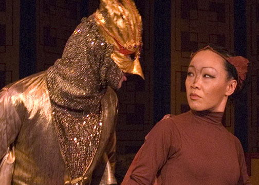 The Fake Nightingale (Mike Tran) sizes up his competition (Deedra Wong).