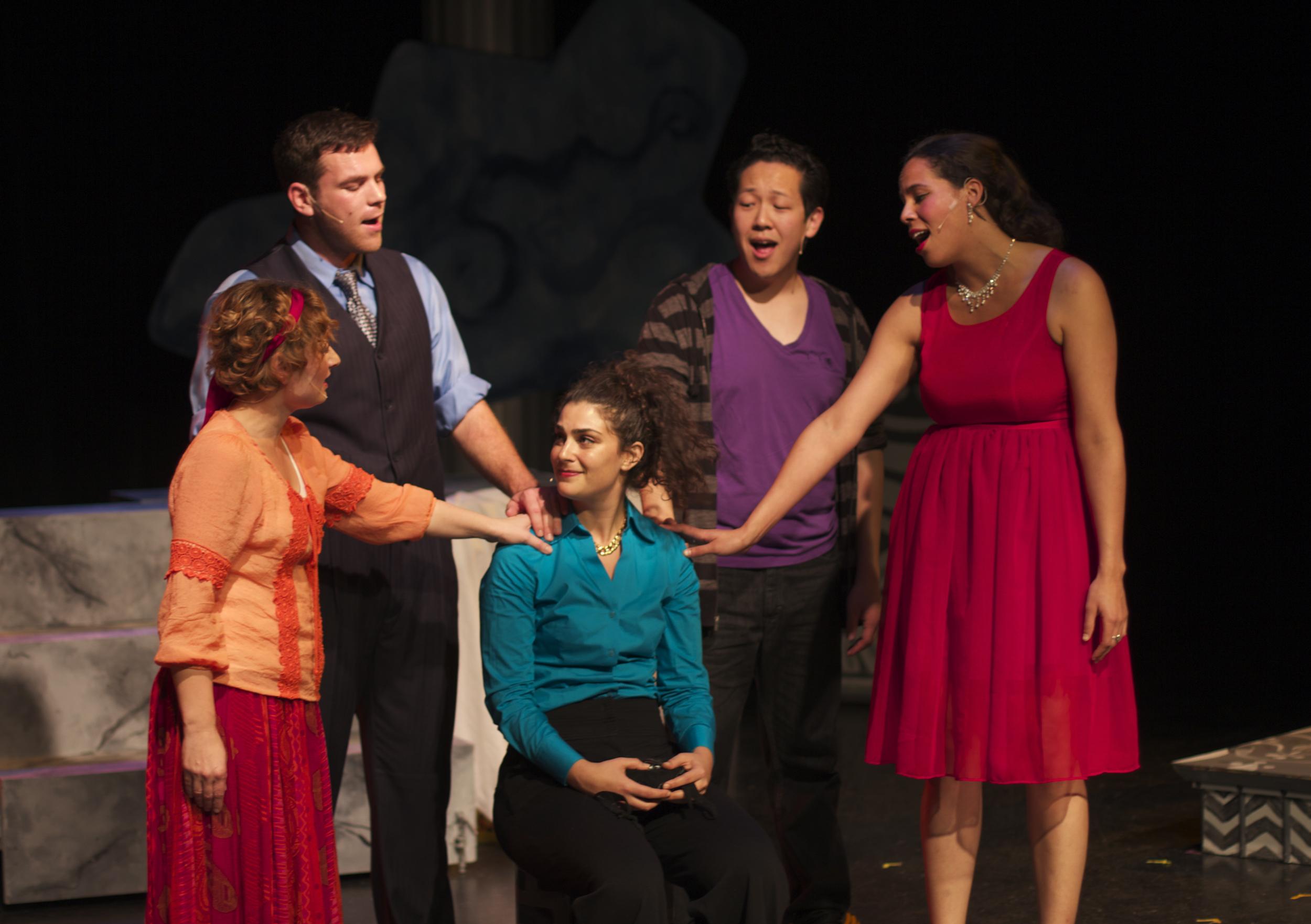 Calliope (Chrissy Brooks), Zeus (Steven Shear), Hermes (Min Kahng) and Aphrodite (Lauren Spencer) tell Athena (Michelle Drexler) she's not so bad.
