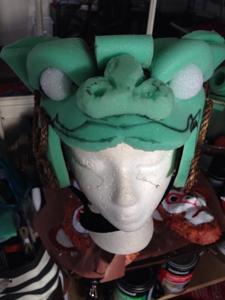 A lion mask in progress.