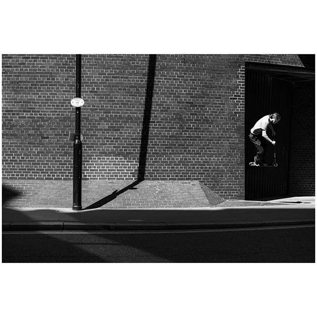 Scooter tricks near the Barbican #blackandwhite #blackandwhitephotography #streetphotography #streetdreamsmag #lensculture #lightandshadow #protectyourhighlights #embraceyourshadows #london #barbican #scooter #stunts #sonya7iii #zeiss55mm18 #lightroommobile #instagram