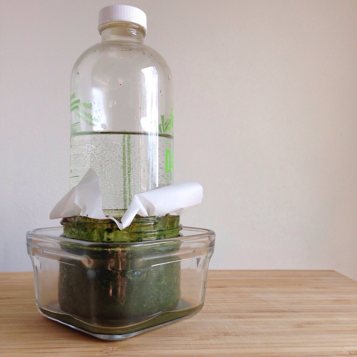 Place a weight on top to keep brine levels above herbs