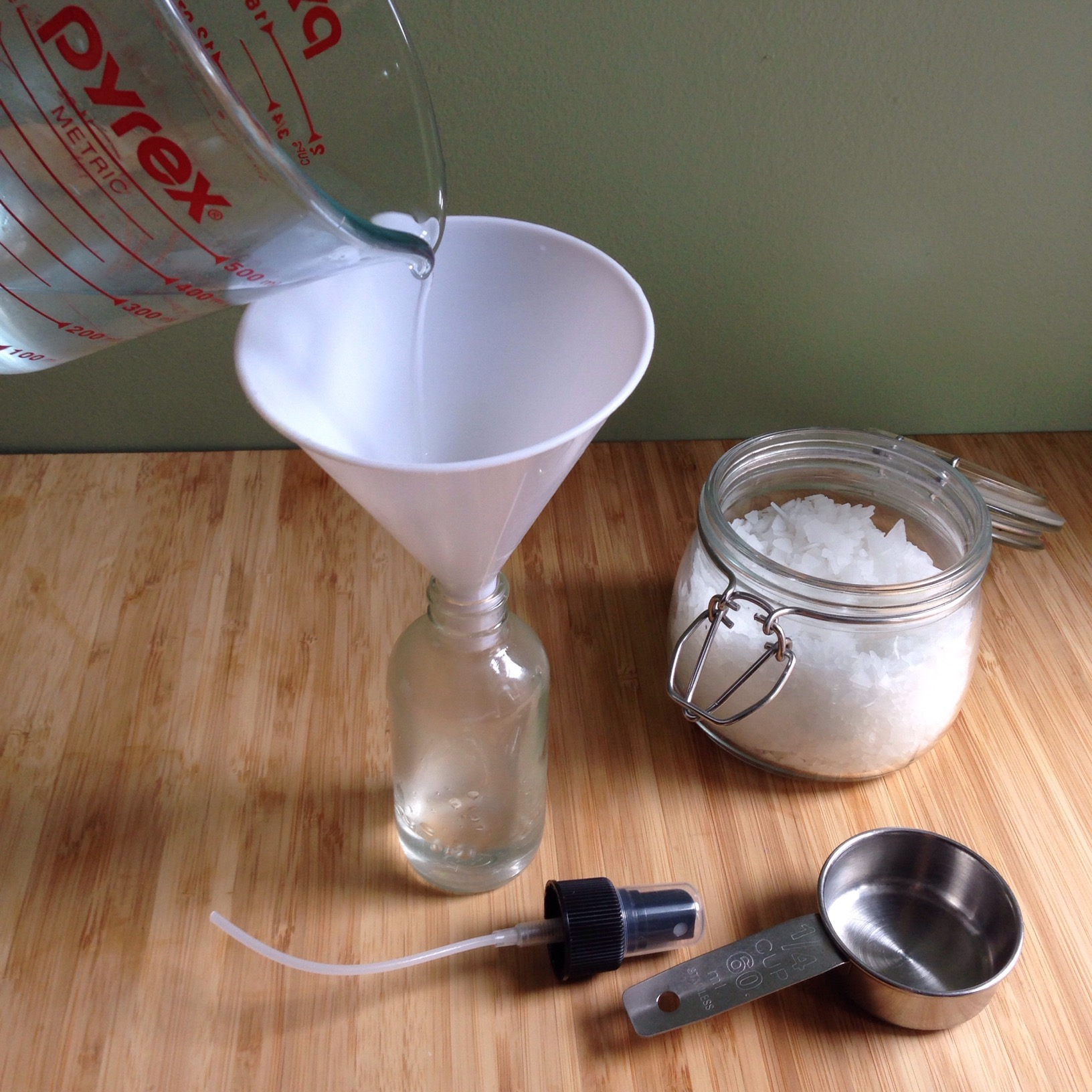 Add to a glass spray bottle with remaining ingredients