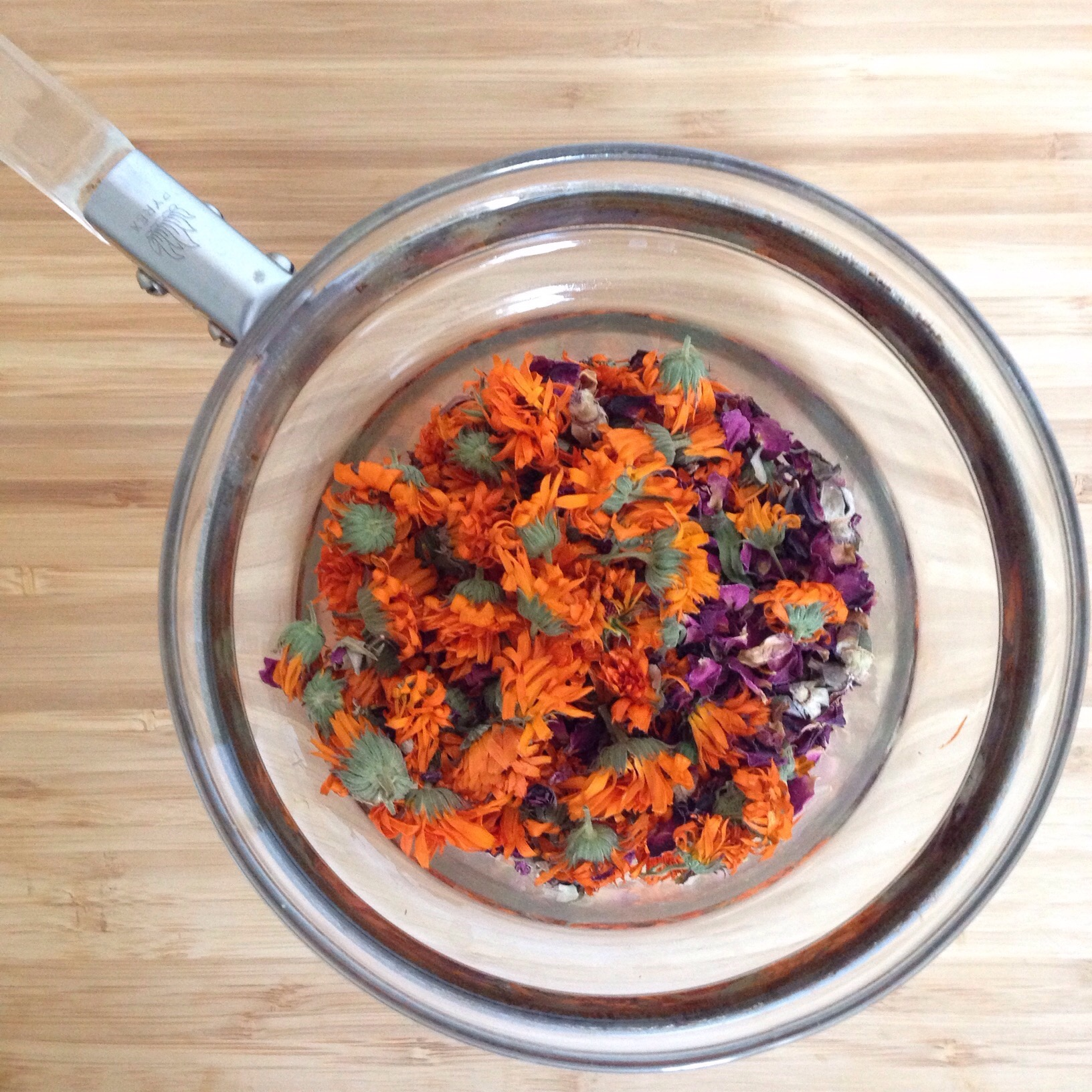Dried calendula and rose petals to infuse into oil in a double boiler