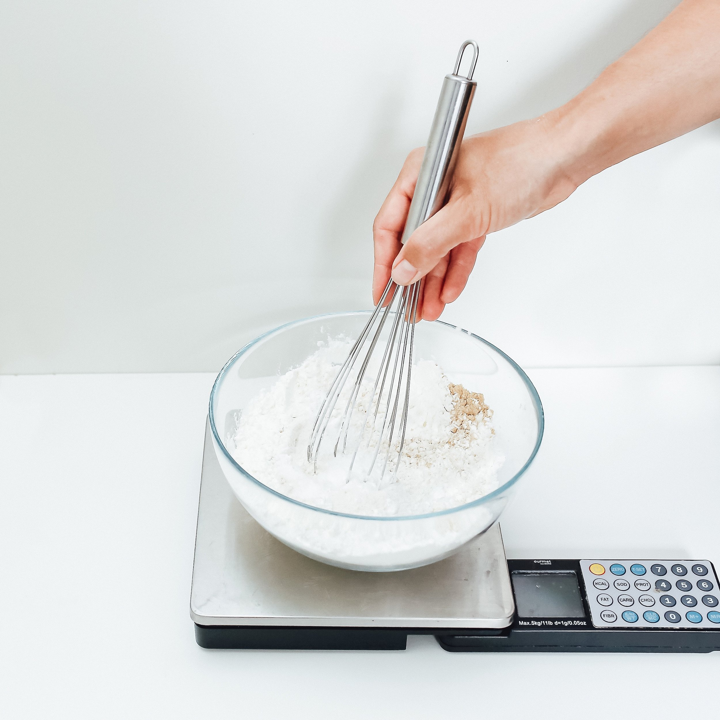 Use a scale to measure dry ingredients and then whisk thoroughly to mix well