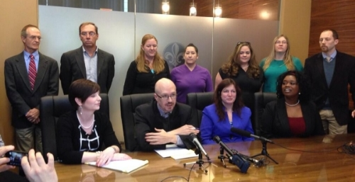 Attorneys and plaintiffs in the Indiana marriage equality case of  Love v. Pence  address the media on March 7, 2014. In the front row, left to right, are attorneys Laura Landenwich, Daniel Canon, Shannon Fauver, Dawn Elliott, and Joe Dunman (standing). Photo courtesy of the  Crimson Student Press Network .