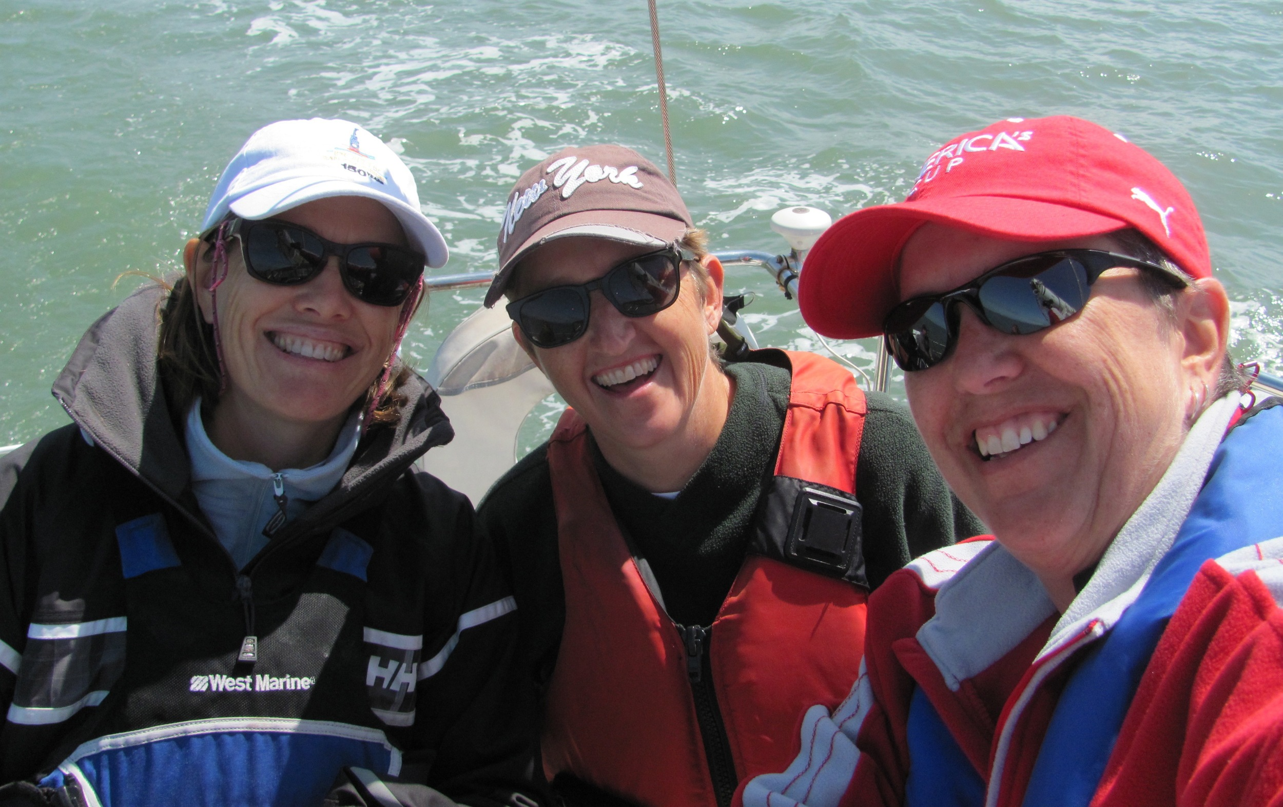 Original SFST members, coaches Jan Crosbie-Taylor and Sallie Lang and current team coordinator Heather Stewart still sailing together 13 years later!
