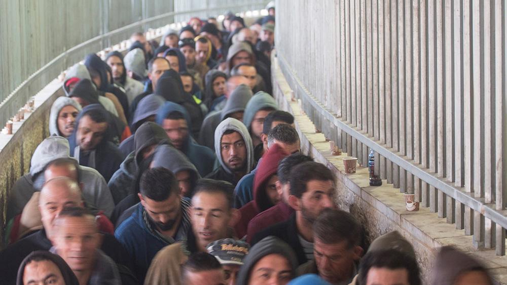 Palestinians at a border checkpoint.