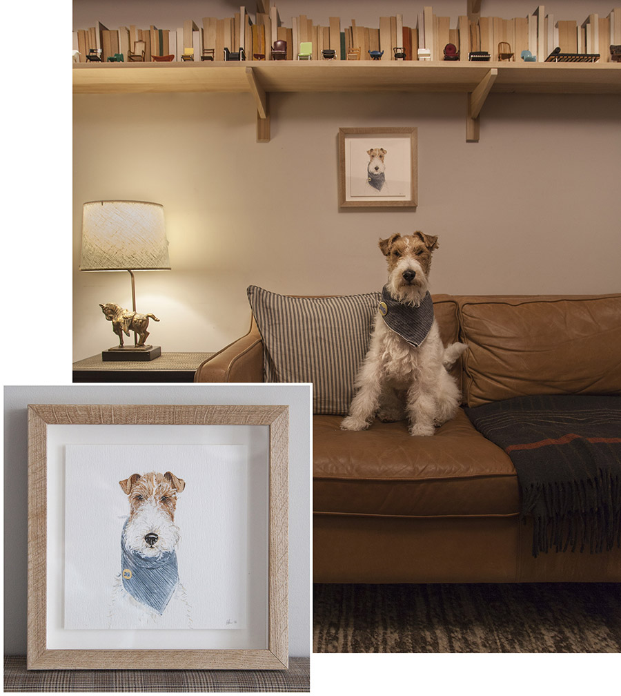 Oliver the wire fox terrier with his portrait in his stylish home in Brooklyn, New York. Photo from his owner Tamara.