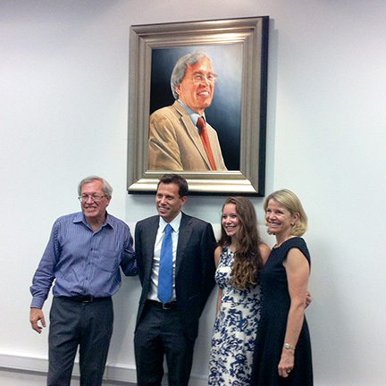 Erwin Chemerinsky with family pose with portrait