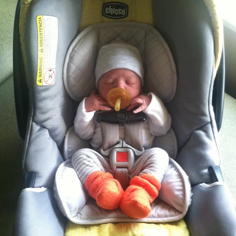 An 8 lb newborn in a Chicco KeyFit 30, using the infant insert and head support that came with the car seat.