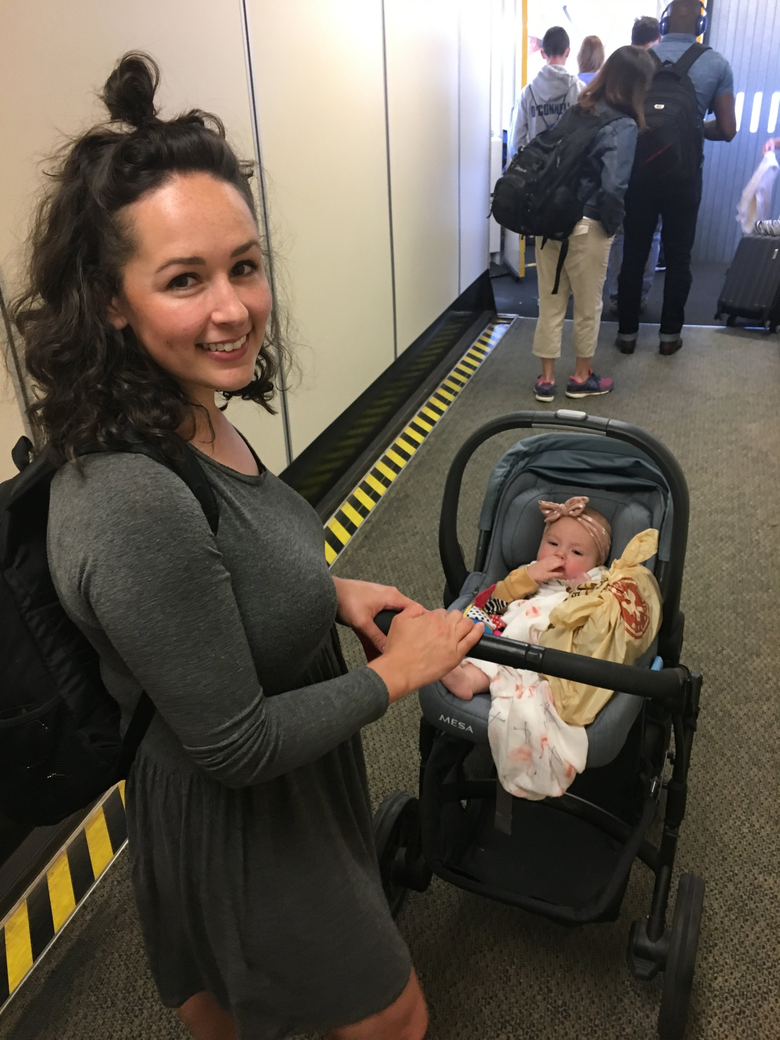 When we got to the gate I removed the car seat, folded the stroller, and boarded.