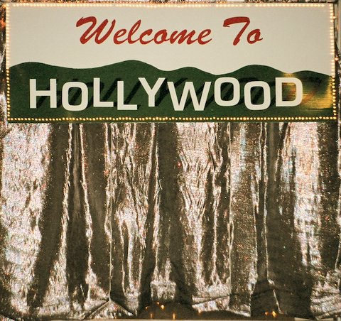 """""""Welcome to Hollywood"""" sign 7' wide by 3' high surrounded by pin lights.Total height 8' high with silver curtain. Great for an entranceway."""